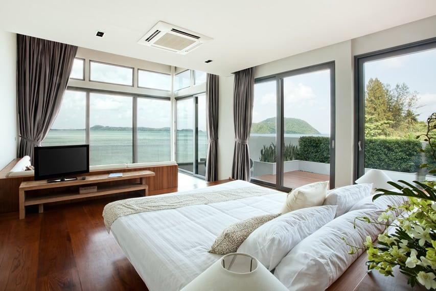 Bedroom with wrap around ocean view