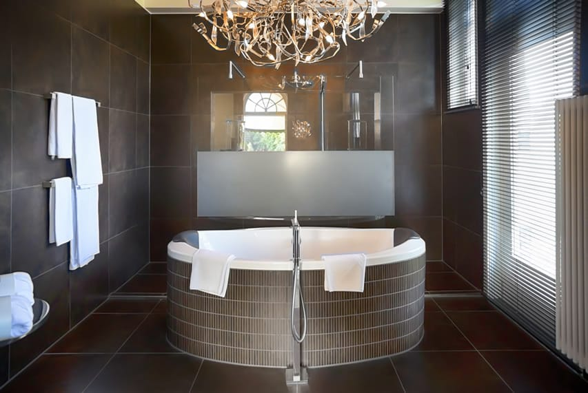 Modern bathroom with 60x60 rustic brown porcelain tiles for walls and floors and rustic brown mosaic tiles