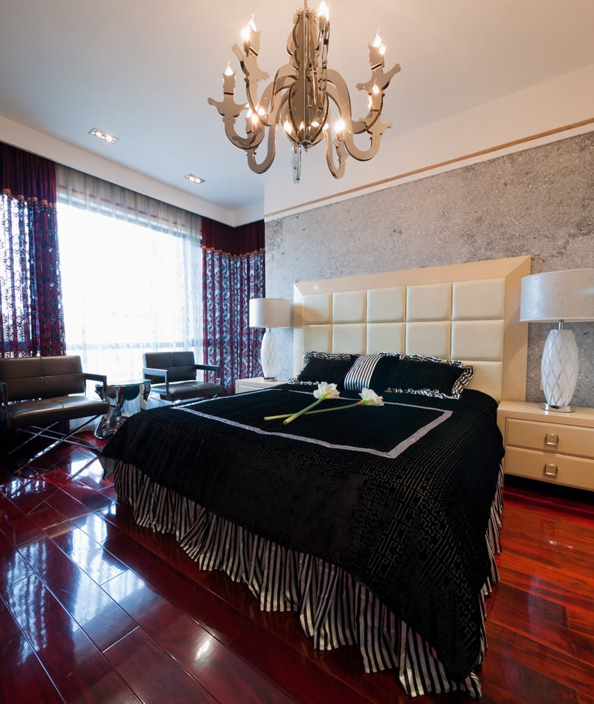Contemporary bedroom with hardwood flooring