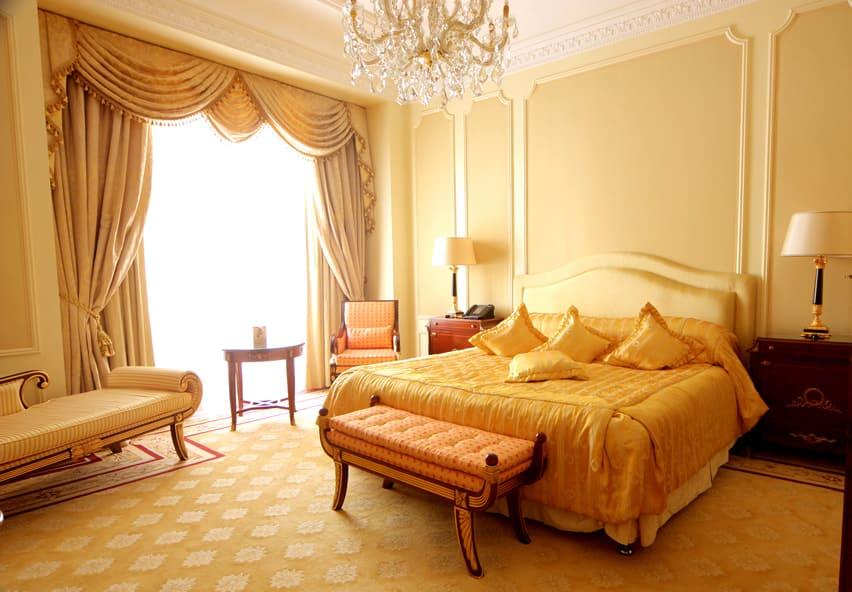 Elegant master bedroom with large crystal chandelier