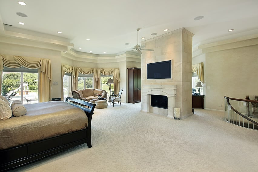 Expansive master bedroom with fireplace and wardrobe