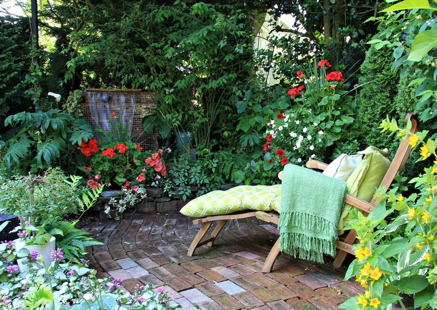 Garden lounge chair near water flow feature