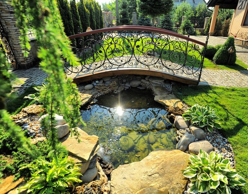 Garden pond with decorative bridge