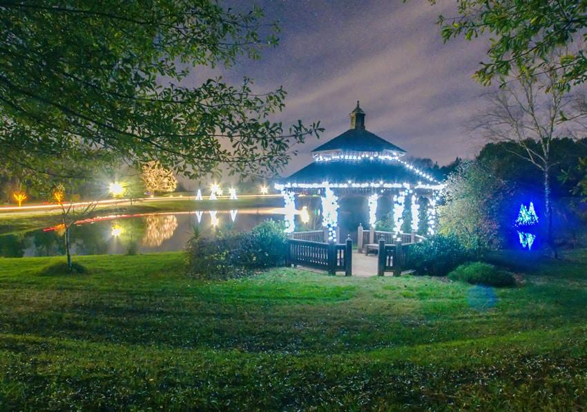 Gazebo on lake at night with lights