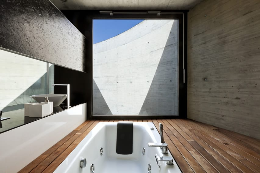 Minimalist bathroom design with floors of cherry finished treated wooden planks
