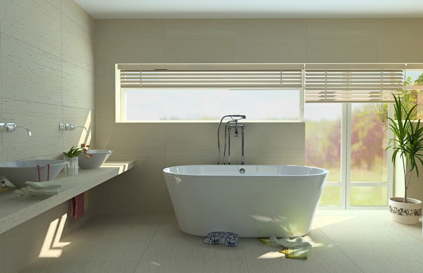 Modern bathroom in white design with travertine floors and vessel sinks