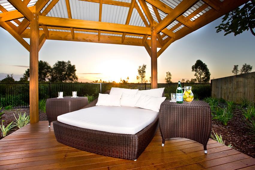 Open top wood gazebo with outdoor bed nightstands