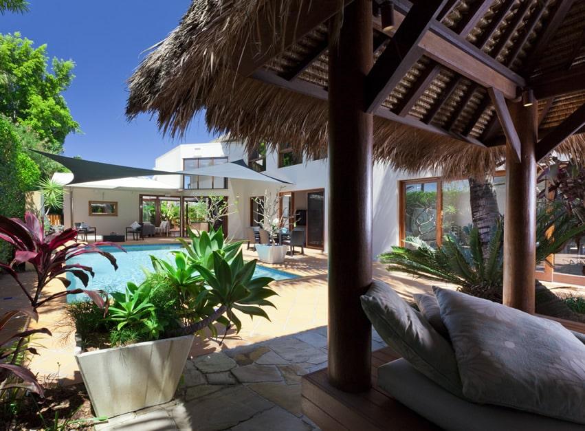 Pool gazebo cabana with tropical setting
