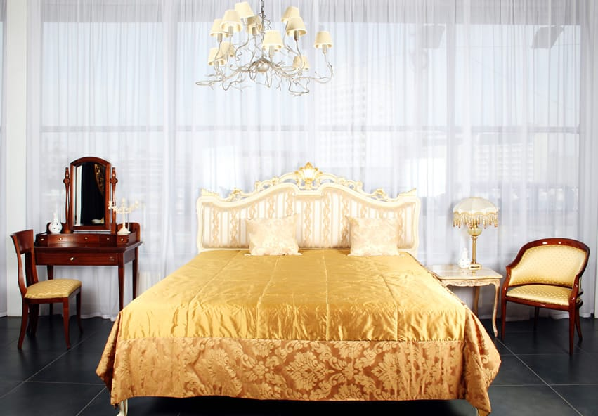 Traditional style bedroom with large curtained window