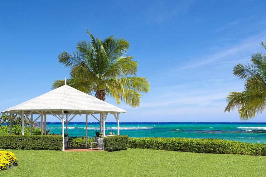 Tropical white gazebo with ocean view