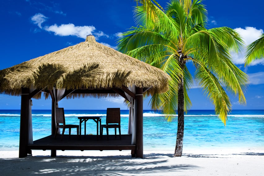 Tropical thatched palapa gazebo with ocean view