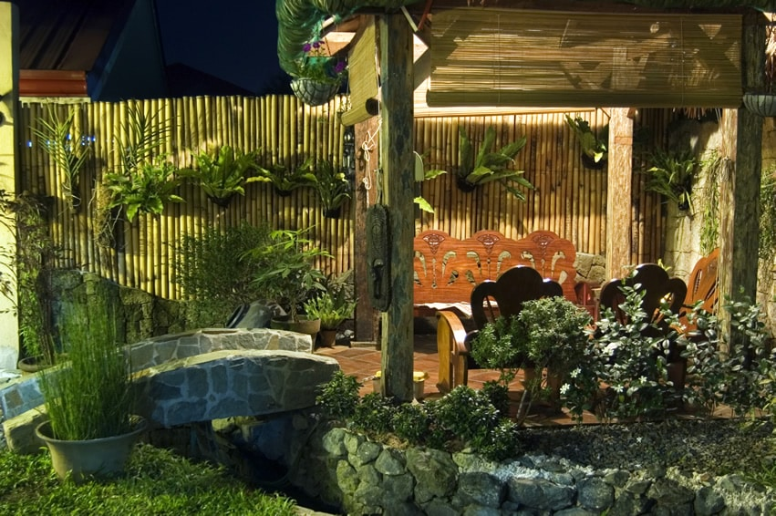 Tropical theme wood gazebo with bamboo decor