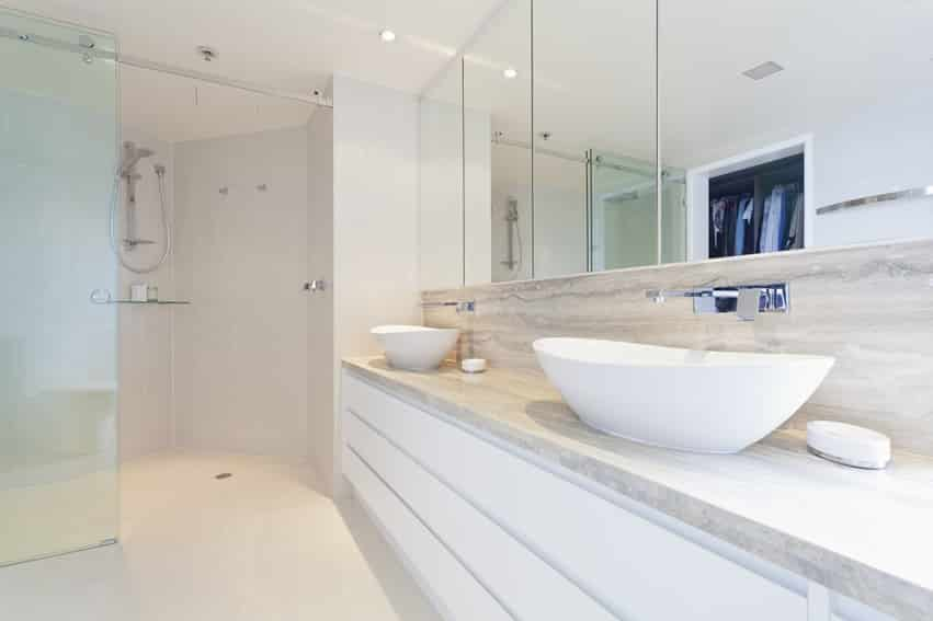 Ultra-modern bathroom uses minimal decor and design materials with vessel sinks