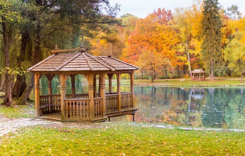 Two wooden gazebos on lake