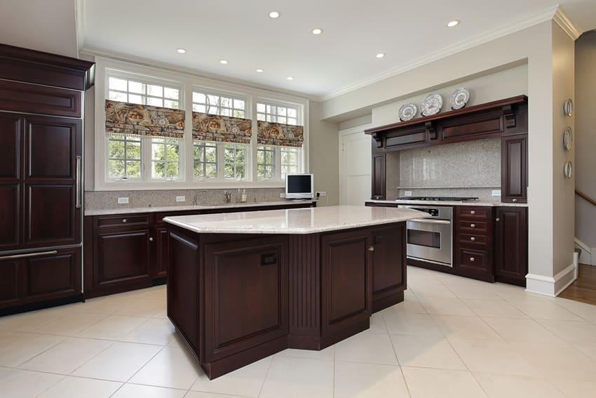 Dark cabinet kitchen with light flooring tiles