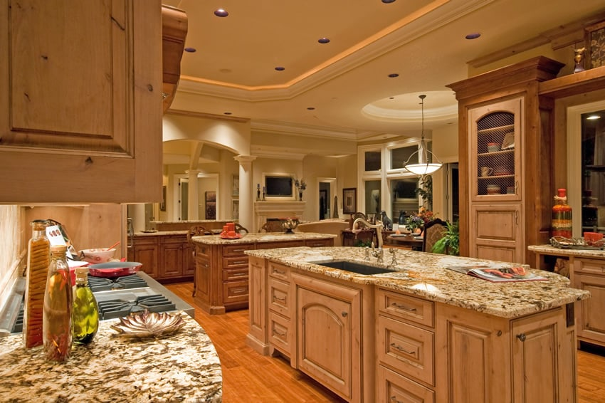 Luxury wood kitchen with granite counters