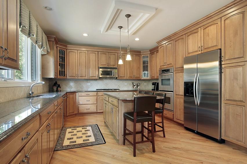Oak kitchen design with eat-in island