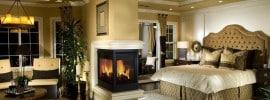 designer-master-bedroom-with-fireplace-in-center