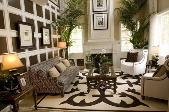 luxury living room with paneled wall large area rug