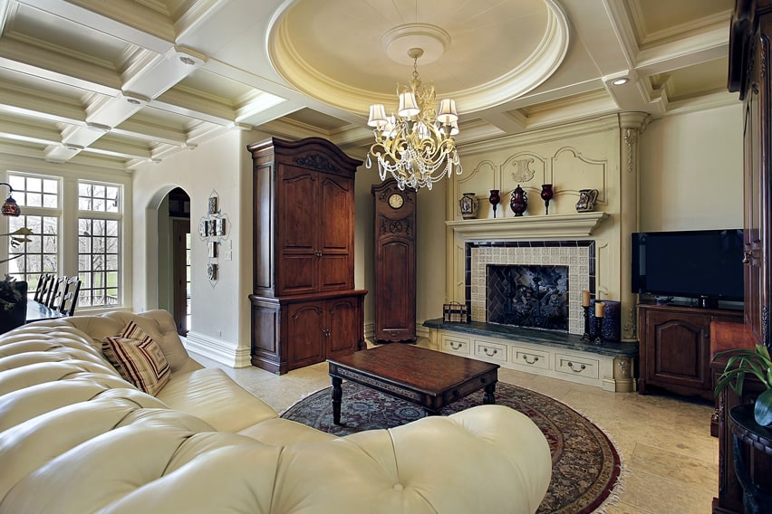 Gorgeous family room with chandelier and plush furniture