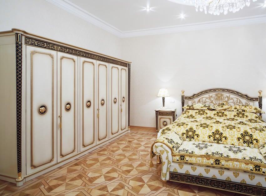 Decorative gold inlay and cream painted wardrobe