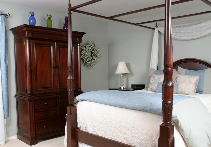 Wood Stained Wardrobe In Bedroom With Four Post Bed