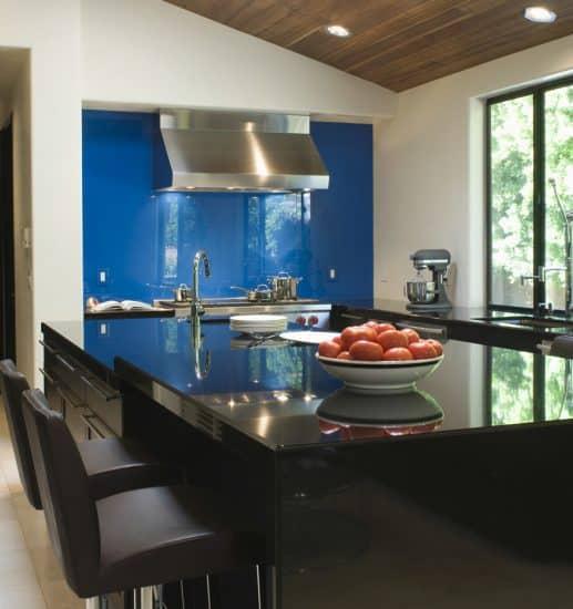 modern kitchen with blue accent wall backsplash
