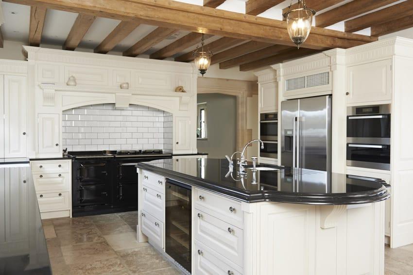 White cabinet and black counter designer kitchen
