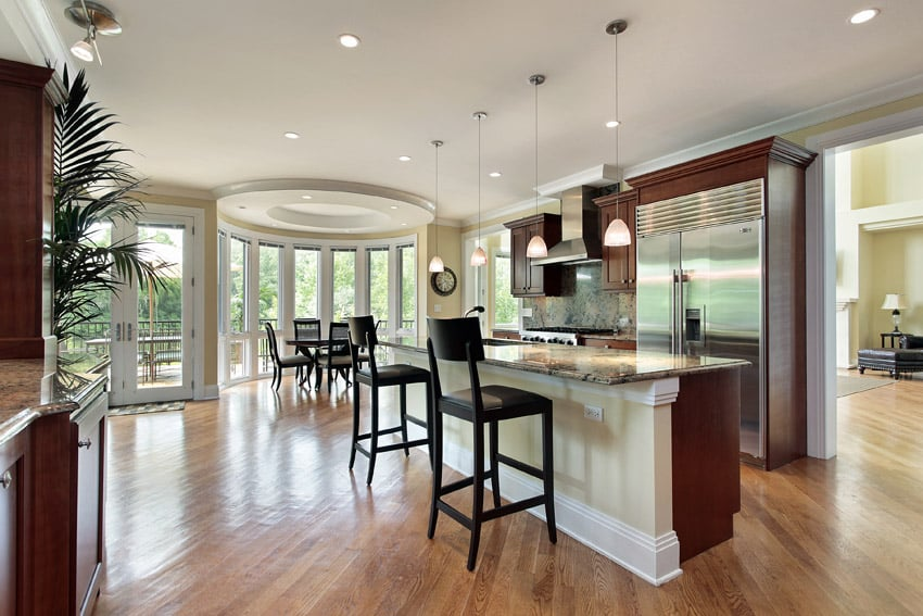 Beautiful Open Layout Kitchen With Rectangular Dining Island And Pendant  Lights
