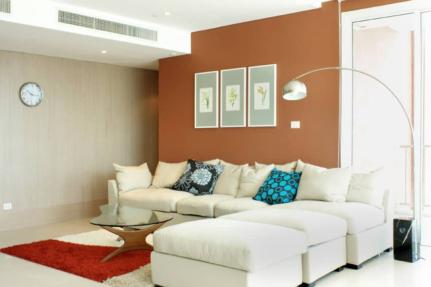 Living room with tan and orange accent walls living room Orange walls living room