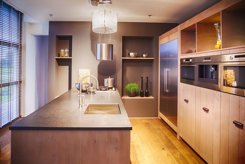 Small modern kitchen with rectangular island and natural wood cabinets