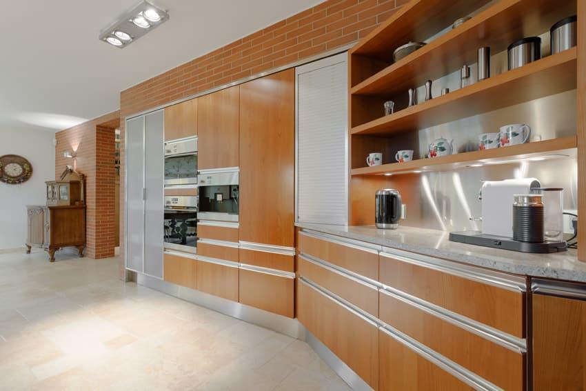 Single line modern kitchen against brick wall