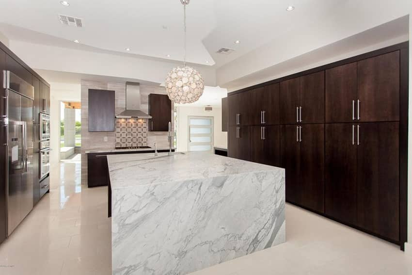 Stylish modern kitchen with round wire ball light and dark cabinetry