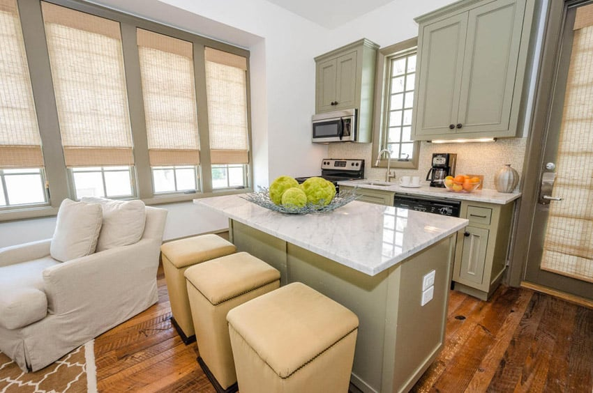 Kitchen island with marble countertop and square stools