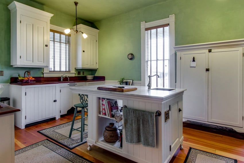 Rustic wood kitchen island in white with under counter storage