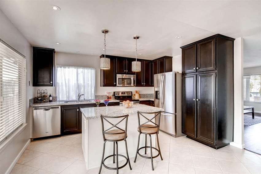 Small kitchen island with snowfall granite counter