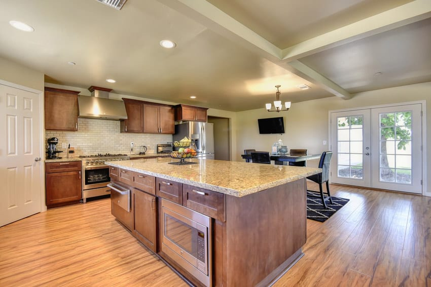 Contemporary kitchen with beige granite topped island
