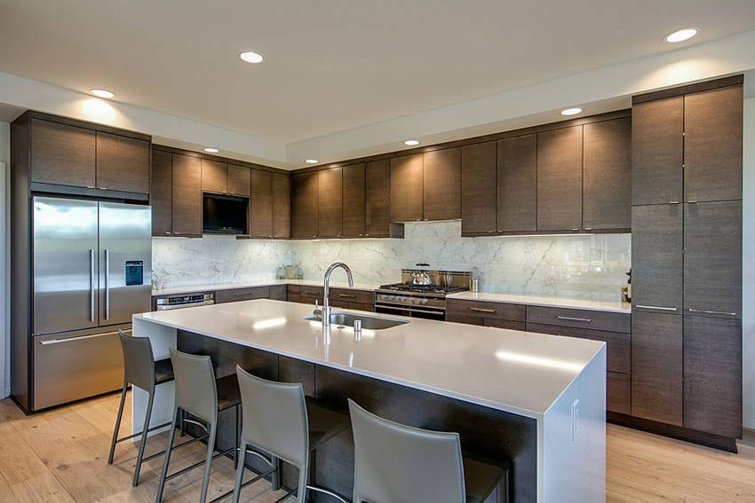 Contemporary kitchen with concrete counter waterfall island