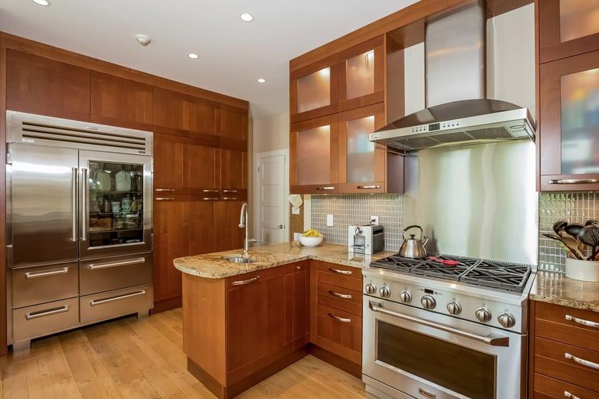 Contemporary kitchen with golden ridge granite counter