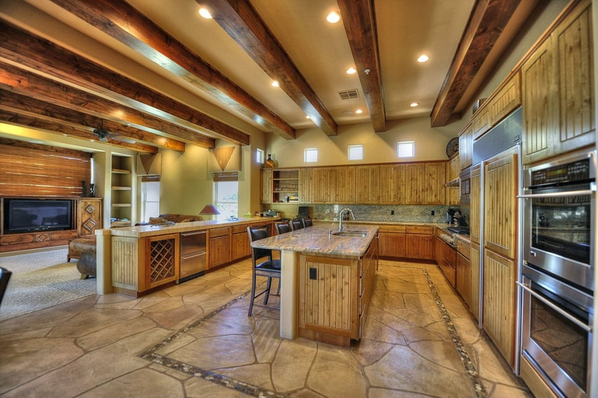 Kitchen with alder cabinets and tasman taupe granite counters