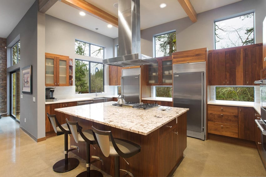 Kitchen with light color granite counters and u shaped design