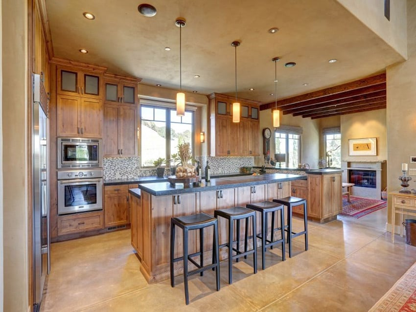 Luxury kitchen with pearl granite counters and eat-in dining island