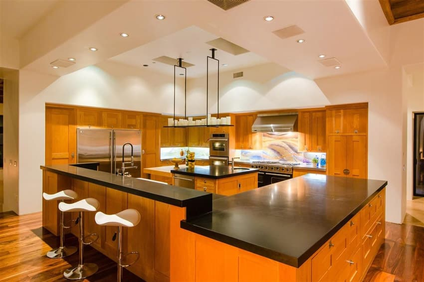 Wood kitchen with solid surface counter island and peninsula