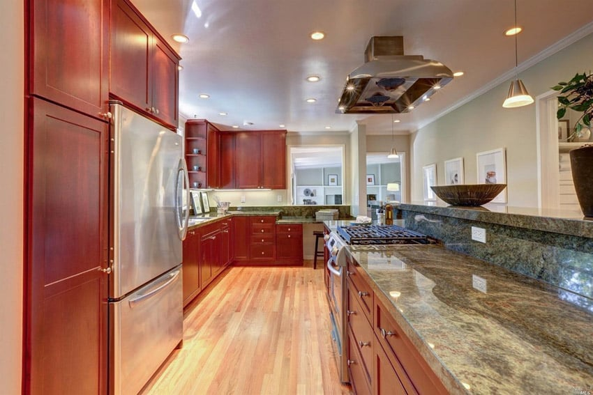 Wood kitchen with rainforest green marble counter