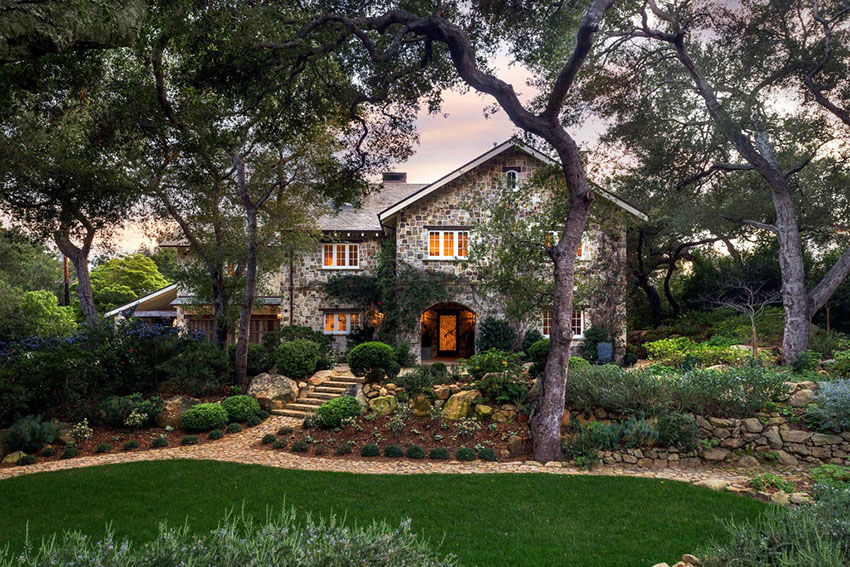 Beautiful cottage with stone walkway through yard