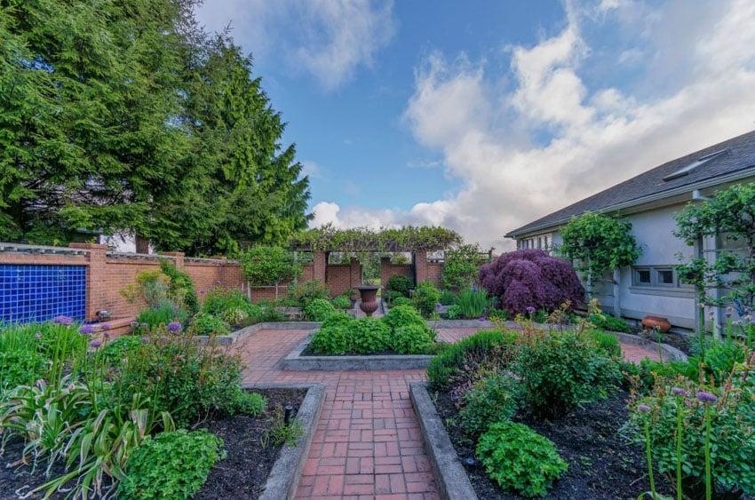 Brick pathway in garden with center planter