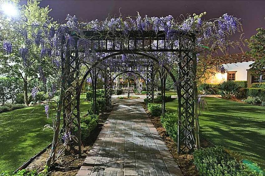 Brick walkway under garden trellis