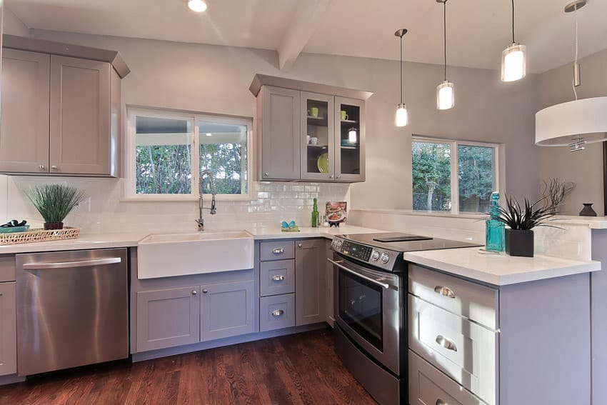 Compact european style kitchen with farmhouse sink