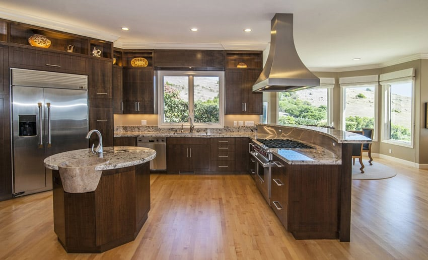 Contemporary dark cabinet kitchen with hardwood flooring