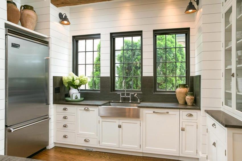 Country kitchen with dark quartz countertops